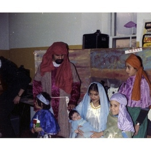 Joseph, Mary, and the baby Jesus are greeted by three wise men during a Three Kings' Day celebration at La Alianza Hispana.