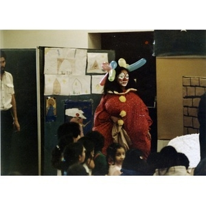 Female clown entertains children at the Three Kings' Day celebration at La Alianza Hispana, Roxbury, Mass.