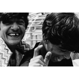 Two Latino youths laughing at an athletic field or playground in Roxbury, Mass., while attending a recreational event sponsored by La Alianza Hispana.