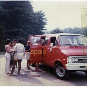 Group of two female and four male Latino youths get into La Alianza Hispana's red van after spending the afternoon at a park and lake, an outing sponsored by La Alianza Hispana.