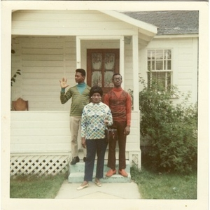 Stephen, David, and Inez Irving Hunter pose on the front steps