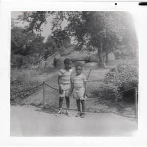 David and Stephen Hunter stand in front of an enclosure.