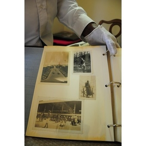 Stephen Hunter poses with his family photo album.