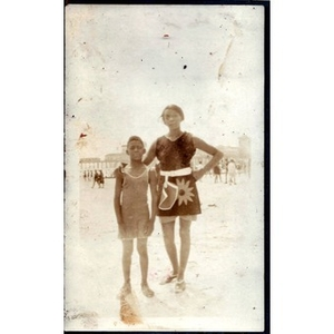 An African American women and a young boy at the beach