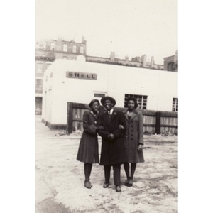 Winifred Irish Hall poses with unidentified friends near Shell station.