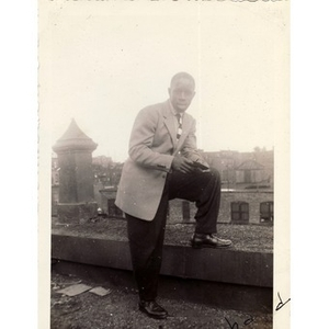 Richard Joseph poses on the roof of a building overlooking Haskins Street in Roxbury, Massachusetts.