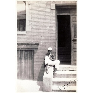 """Brother"" Irish sits on the steps to his home on Haskins Street."