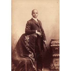 An African-American man in formal dress with a cane.