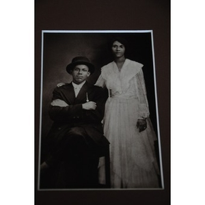 An African American couple in formal wear.