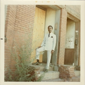 Reverend Michael E. Haynes stands on the stairs of an abandoned building in Lower Roxbury.