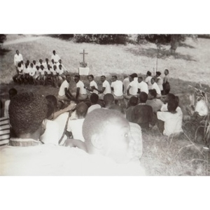 A group of campers gather for a religious service at Breezy Meadows Camp.