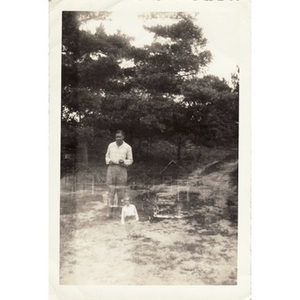 A double exposure of a man in a field and in front of some houses
