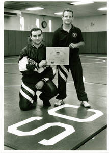 Daryl Arroyo and Dan Transue holding All-American award (1993-1994)