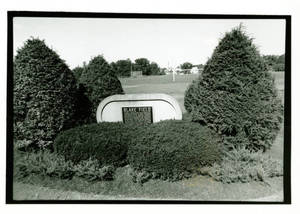 Blake Field plaque surrounded by bushes (1993-1994)