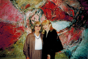 Alison Laing and Rikki Swin Pose in Front of Artwork