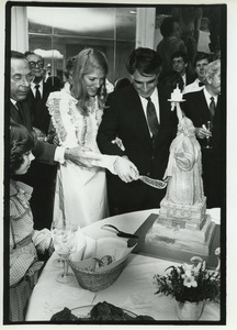 Andrew Stein and Lynn Forester cutting wedding cake