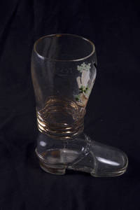 A blown glass boot with gymnastic scene