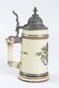 A porcelain stein with 4F Turner shield and verse.