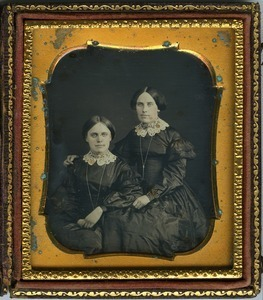 Emily (r.) and Hannah Cornelia Scott: double three-quarter length studio portrait with arm around