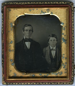 Rufus Scott and son Aaron: double half-length studio portrait, seated, facing camera
