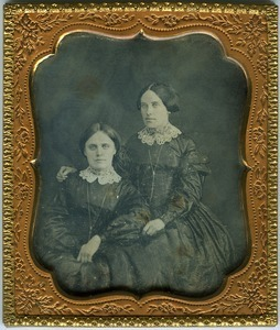 Emily and Hannah Cornelia Scott: double half-length studio portrait, seated, with arm around