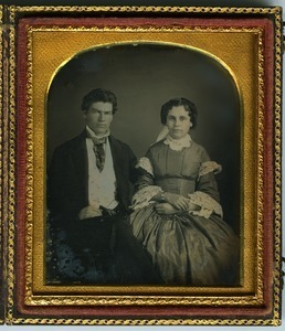 Laura B. Dodge and husband: double three-quarter length studio portrait, seated
