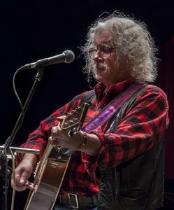 Arlo Guthrie (guitar) performing at Symphony Space, New York City, in a concert to pay tribute to George Wein