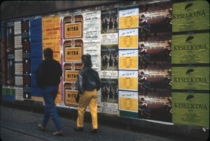 Advertisements posted on a street wall