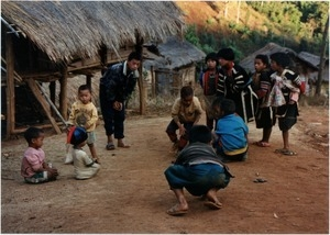 Young boys playing game in rural village, Southern Thailand