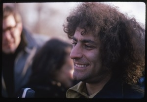 Abbie Hoffman, smiling in a crowd