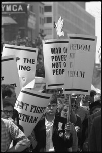 Antiwar protesters during the March on Washington carrying signs 'Freedom now in Vietnam,' 'War on Poverty, not on people,' and 'I won't fight in Vietnam'