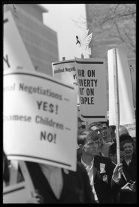 Antiwar protesters during the March on Washington carrying signs 'War on poverty, not on people'