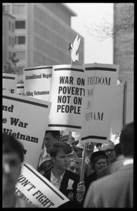 Antiwar protesters during the March on Washington carrying signs 'Freedom now in Vietnam,' 'War on Poverty, not on people,' and 'End the war in Vietnam'
