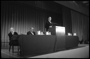 Arthur M. Schlesinger, Jr., speaking at the National Teach-in on the Vietnam War, with other panelists Hans J. Morgenthau (left) and Isaac Deutscher