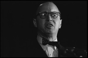 Arthur M. Schlesinger, Jr., speaking at the National Teach-in on the Vietnam War: close-up portrait, standing at the podium