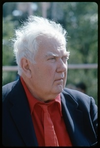 Alexander Calder: three-quarter profile bust portrait in a red tie