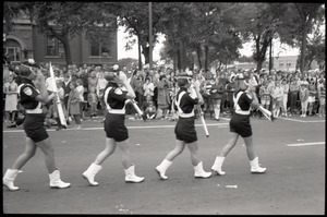 All-woman drill team in the parade for Robert F. Kennedy's visit, marching past the court house on10th Street during the Turkey Day parade
