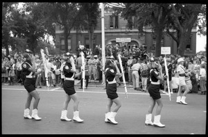 All-woman drill team in the parade for Robert F. Kennedy's visit, marching past the court house on 10th Street during the Turkey Day parade