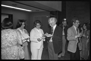 Andy Warhol signing autographs at a reception at the Birmingham Museum of Art
