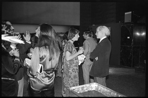 Andy Warhol mingling with attendees at a reception at the Birmingham Museum of Art