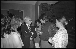 Andy Warhol mingling with the crowd at a reception at the Birmingham Museum of Art