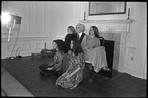 Andy Warhol posed in front of a fireplace, surrounded by four women, during a reception at the Birmingham Museum of Art