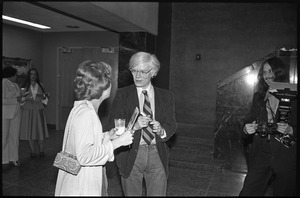 Andy Warhol mingling at a reception at the Birmingham Museum of Art