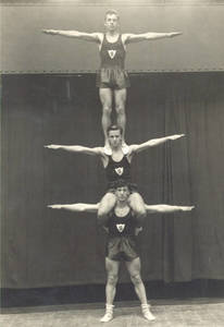 Three Gymnasts Balancing on Each Other