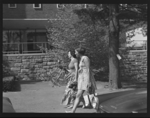 Photographs of students outside on campus, 1974 May 15