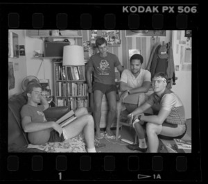 Photographs of students in dorm room, 1985 July