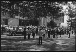 Photographs of Leaves of Grass performing on the steps of Robert Frost Library, 1968 May 10