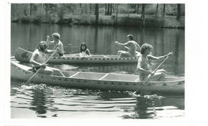 Students riding in canoes at Freshman Camp