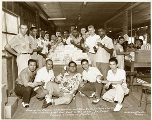 The Harlem Globetrotters and the New York Celtics at the La Perla Cigar and Cigarette Factory in Paranaque, Philippines on September 3, 1952.