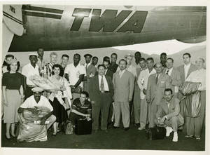 The Harlem Globetrotters under a TWA airplane, 1952